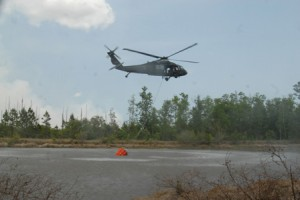 Fla. Army National Guard's Black Hawk helicopter picks up water in a bucket during Florida fires in 2007