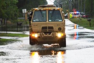 Soldiers in a high-water military vehicle from the Florida National Guard's 144th Transportation Company make their way through flooded roads near Santa Rosa Beach, Fla., April 30, 2014. More than 50 Florida Army National Guard Soldiers responded with high-water military vehicles to assist civilian first responders during flooding in Florida's panhandle. Photo by Master Sgt. Thomas Kielbasa