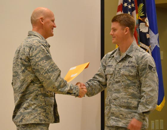 Brig. Gen. James Eifert (left) congratulates an Airman who graduated from the Battlefield Weather Initial Qualification Training (BWIQT) Course during a ceremony at Camp Blanding Joint Training Center, Sept. 27, 2014. Photo by Master Sgt. Thomas Kielbasa