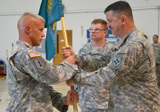 Incoming Commander of the 48th Civil Support Team Lt. Col. Thomas Benton (left) accepts the unit guidon from Commander of the 83rd Troop Command Col. Paul Chauncey (right) during a Change of Command ceremony in Clearwater, Fla., Sept. 5, 2014. Benton follows Lt. Col. Joseph DeFee (center) as commander of the specialized WMD-response unit. Photo by Master Sgt. Thomas Kielbasa