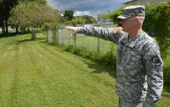 Sgt. 1st Class Shaun Ausborn of the Florida Army National Guard's D Battery, 3rd Battalion, 265th Air Defense Artillery Regiment, shows where he hopes to create a sustainable community fruit and vegetable garden on the acre of land adjacent to his unit's motor pool on 13th Avenue East in Bradenton, Fla. Photo by Master Sgt. Thomas Kielbasa