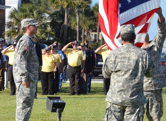 Members of a Vietnam veterans platoon salutes as the flag is lowered during a Florida National Guard Vietnam War commemoration at the historic St. Francis Barracks in downtown St. Augustine, Nov. 7, 2014. Twenty-eight Vietnam veterans were honored for their military service during the ceremony commemorating the 50th anniversary of the Vietnam War. Photo by Master Sgt. Thomas Kielbasa