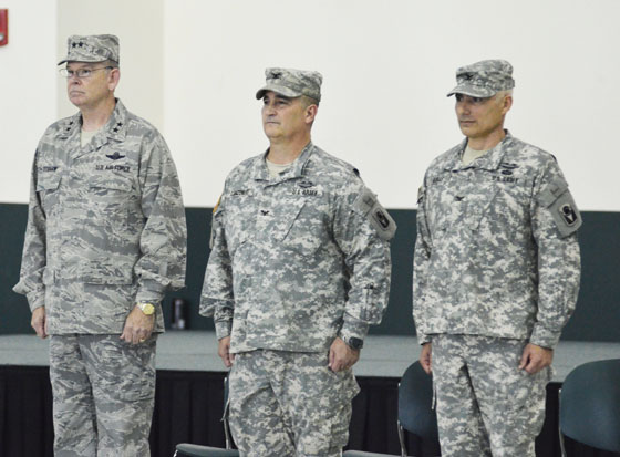 Adjutant General of Florida Maj. Gen. Emmett Titshaw Jr. (left) joins outgoing commander of the 53rd Infantry Brigade Combat Team Col. Mike Canzoneri (center) and incoming commander Col. Ralph Ribas during the unit's change of command ceremony on Jan. 10, 2015, in Pinellas Park, Fla. Photo by Master Sgt. Thomas Kielbasa