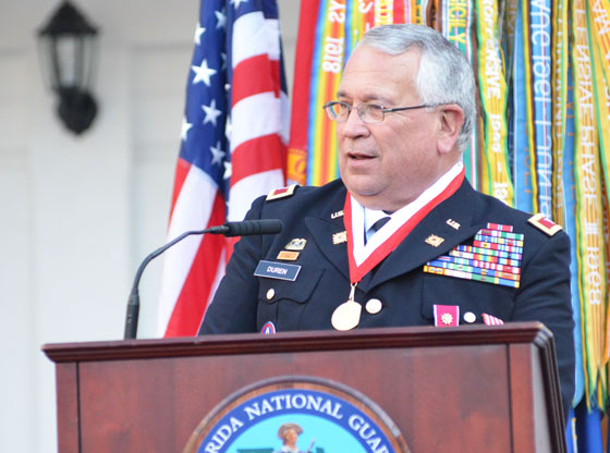 "Col. Joseph ""Mickey"" Duren speaks during his retirement ceremony Feb. 20, 2015, at the St. Francis Barracks in St. Augustine, Fla. Photo by Master Sgt. Thomas Kielbasa"
