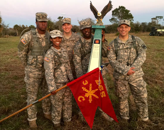 A team of C Battery (Palmetto) led by 1st Lt. Daniel with team mates Staff Sgt. Osby, Staff Sgt. Florexil, Sgt. Hamilton and Sgt. Atkins receive the 2015 Top Team recognition for 3-265th ADA BN. Photo by Capt. Arthur Gaines