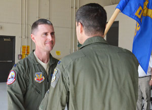 Incoming Commander of the Florida Air National Guard's Det. 1, 125th Fighter Wing, Lt. Col. Scott Gilloon (left), accepts the unit guidon from Commander of the 125th Fighter Wing Col. Brian Simpler during an assumption of command ceremony at Homestead Air Reserve Base, Fla., Feb. 17, 2015. Photo by Master Sgt. Thomas Kielbasa