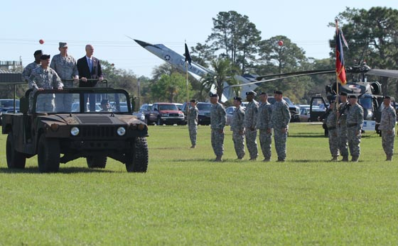 Gov. Rick Scott, Commander in Chief of the Florida National Guard, Maj. Gen. Emmett R. Titshaw Jr., outgoing Adjutant General of Florida, Maj. Gen. Michael A. Calhoun, incoming Adjutant General of Florida and Col. Mike A. Canzoneri, Commander of Troops, conduct the 'inspection of troops' during a Change of Command ceremony at the Camp Blanding Joint Training Center (CBJTC), Fla. parade field, Sunday, March 29, 2015. During the ceremony Calhoun assumed command from Titshaw, who retired after 45 years of service. Photo by Sgt. Spencer Rhodes