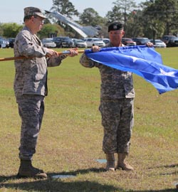 Maj. Gen. Emmett R. Titshaw Jr., outgoing Adjutant General of Florida, retires his flag with assistance from Command Sgt. Maj. Robert M. Hosford, Senior Enlisted Advisor, during a Change of Command ceremony at the Camp Blanding Joint Training Center (CBJTC), Fla., parade field, Sunday, March 29, 2015. Photo by Sgt. Spencer Rhodes