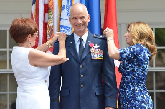 Family members pin the silver star rank on newly promoted Brig. Gen. Thomas Cucchi, during a military ceremony at the St. Francis Barracks in downtown St. Augustine, Fla., May 8, 2015. Photo by Master Sgt. Thomas Kielbasa