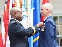 Adjutant General of Florida Maj. Gen. Michael Calhoun (left) awards a Legion of Merit medal to Col. Thomas Cucchi at the beginning of his one-star promotion ceremony in St. Augustine, Fla., May 8, 2015. Photo by Master Sgt. Thomas Kielbasa